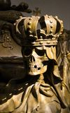 Skull on Charles VI's coffin - The Imperial Crypt, Vienna, Austria. Death';s head wearing a crown placed on a corner of Charles VI's casket - The stock photography