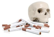 Skull and cigarettes Royalty Free Stock Photo