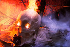 Skull with cloth and fire angle view. Stock Photos