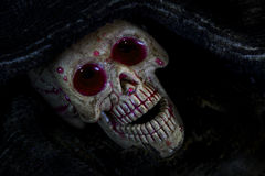 Skull in the cloth wrap and blood  over black. Royalty Free Stock Photos
