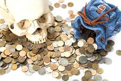 Skull and  coin. Human skull and purse with coin Stock Photo