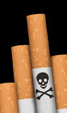Skull and crossbones in cigarette. Skull and crossbones hazzard sign in cigarettes Stock Photo