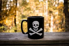 Skull and Crossbones Coffee Mug Stock Photos