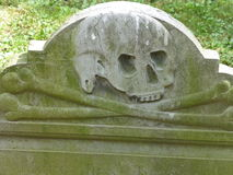 Skull and Crossbones. A skull and crossbones decorates an old headstone in Granary Burying Ground, Boston, Massachusetts Royalty Free Stock Image