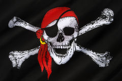 Skull and Crossbones Flag - Jolly Roger. The skull and crossbones is a representation of a skull with two thigh bones crossed below it as an emblem of piracy or Stock Photo