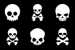 Skull and crossbones icons in cartoon style Royalty Free Stock Photography