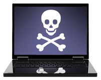 Skull and crossbones on the laptop screen. Stock Photography