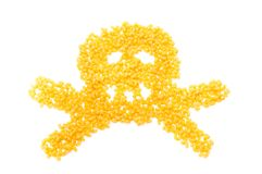 Skull and crossbones made of pasta. Isolated on white background Royalty Free Stock Image