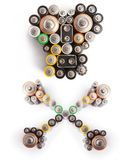 Skull and crossbones made from various batteries - Environmental Stock Images