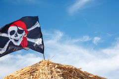 A skull and crossbones pirate flag waving in the wind., Jolly Roger, Pirates flag stock photos