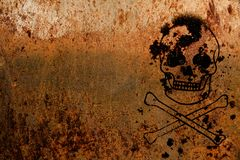 Skull and crossbones symbolic for danger and life threatening painted over a rusty metal plate texture background. And empty copy space to the side Royalty Free Stock Images