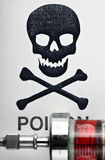 Skull and crossbones on a syringe with medicine Royalty Free Stock Photography