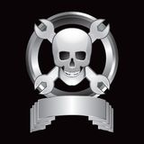 Skull and crossed wrenches in silver display Stock Photos