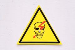 Skull danger sign. Mortal danger sign isolated over white Stock Images