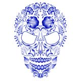 Skull decorated with blue pattern in Gzhel style on a white background. Stock Photos