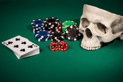 Skull, dice, cards and chips Stock Photography