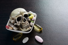Skull and diferent Tablets pills capsule heap mix therapy drugs Stock Photo