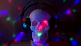 Skull at the disco. Skull rocking to good music, Skull at the disco stock footage