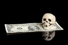 Skull on dollar bill Royalty Free Stock Photos