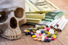 Skull of dollars, pills, drugs and syringes. Royalty Free Stock Images