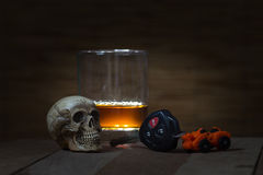Skull and Drinking Don't Driving Still Life Stock Images