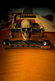 Skull and electric guitar Stock Photography