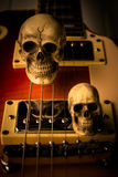Skull and electric guitar Stock Photo