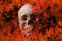 Skull and fire. A human skull with fire in the background Royalty Free Stock Photography