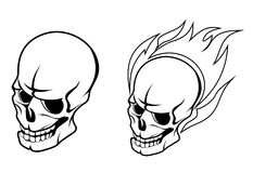 Skull with fire flame Stock Photos