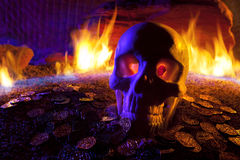 Skull, Fire and Gold Coins Stock Photography