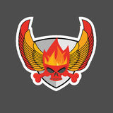 Skull with flames on the shield and wings. Heraldry Royalty Free Stock Photos