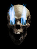 Skull with flaming eyes. Skull with blue flaming eye sockets over black background royalty free stock photo