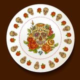 Skull and Flowers on a white plate Royalty Free Stock Photography