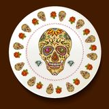 Skull and Flowers on a white plate Stock Images