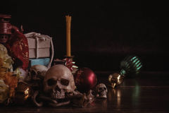 Skull and gifts on wooden. Skull and gifts for the festival on the old wooden Royalty Free Stock Image