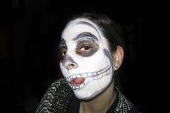 Skull girl on black background Stock Image