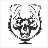 Skull in glass - Alcohol addiction Stock Photography