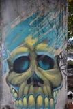 Skull graffiti on a concrete column in Portland, Oregon stock images