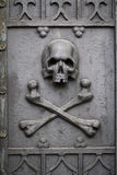 Skull on grave door. Stock Photography
