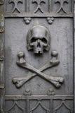 Skull on grave door. stock photography