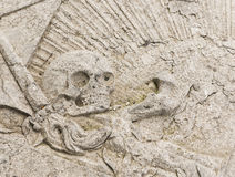 Skull on gravestone Stock Photos