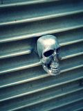 Skull grille. A chrome skull ornament of the grille of a hot rod Royalty Free Stock Photos