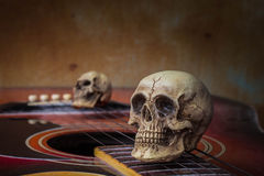 The skull on the guitar Stock Photos