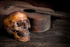 Skull and guitar on wood, Royalty Free Stock Photo