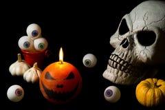Skull. halloween. eyeballs.candle. pumpkin Stock Photos