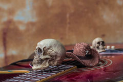 Skull and hat on a classical guitar. Royalty Free Stock Images