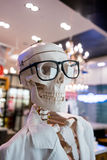 Skull head wearing eyeglasses and white scientific lab coat stock images