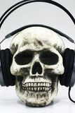 Skull with headphones. A Human skull with headphones Stock Photography