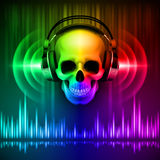 Skull in headphones. Disco background Royalty Free Stock Photo