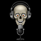 Skull with headphones with microphone royalty free illustration